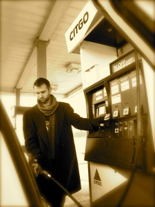I enjoy pretending John is famous and I'm his paparazzi. Look! John pumps gas, just like a real person!